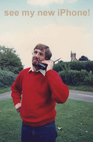 early pic of me using big early mobile phone